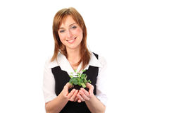 Woman holding a plant Royalty Free Stock Photo