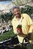 Woman Holding Plant At Botanical Garden Stock Image