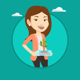 Woman holding plant growing in plastic bottle. Royalty Free Stock Photo