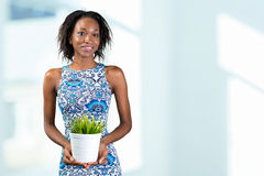 woman holding plant in vase Stock Photography