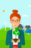 Woman holding plant. Royalty Free Stock Photos
