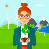 Woman holding plant. Stock Image