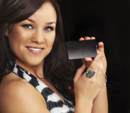 Woman holding a plastic card. stock photography