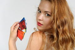 Woman holding a plastic card Stock Photography