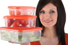 Woman holding plastic storage Stock Photos