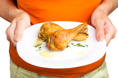 Woman holding plate with chicken legs Royalty Free Stock Photos