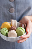 Woman holding plate with French macarons Stock Image