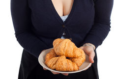 Woman holding plate with fresh croissants Stock Photography