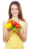 Woman holding plate of fresh vegetables Stock Image