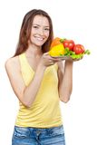 Woman holding plate of fresh vegetables Stock Photography