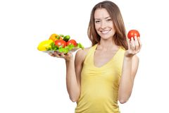 Woman holding plate of fresh vegetables Royalty Free Stock Photos