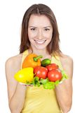 Woman holding plate of fresh vegetables Royalty Free Stock Image