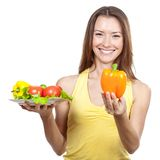 Woman holding plate of fresh vegetables Stock Photo