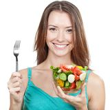 Woman holding plate of fresh vegetables Royalty Free Stock Photography