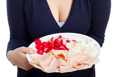 Woman holding plate with ham, radishes and onion Royalty Free Stock Photography