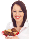 Woman Holding a Plate of Indian Style Snacks Stock Photography