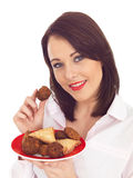 Woman Holding a Plate of Indian Style Snacks Stock Photo