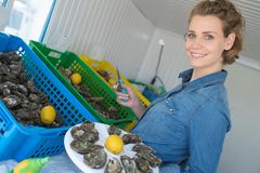 Woman holding plate oysters Stock Photo