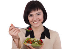 Woman holding plate with salad and eating Royalty Free Stock Photography