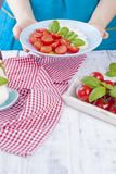 A woman is holding a plate with a traditional Italian salad caprese. Tomatoes and mazarella cheese. Healthy food. Free space for. Text royalty free stock photo