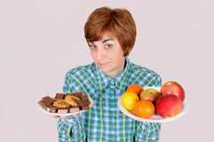 Woman holding plates with fruit and sweets Royalty Free Stock Images