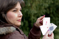 Woman holding playing cards Stock Images
