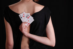 Woman holding playing cards Royalty Free Stock Images