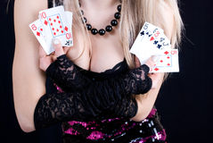 Woman holding playing cards Stock Image