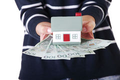 Woman holding PLN bills and house model Royalty Free Stock Image