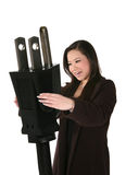 Woman Holding Plug royalty free stock image