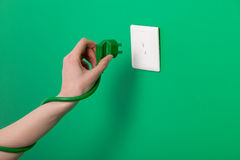 Woman holding plug Royalty Free Stock Image