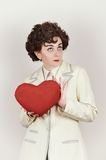 Woman holding a plush red heart Royalty Free Stock Image