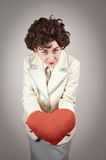 Woman holding a plush red heart Stock Photography
