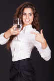 Woman holding and point to a glass of water Royalty Free Stock Image