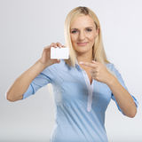 Woman holding and pointing to blank card Stock Photos
