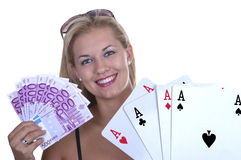 Woman while holding a poker hand of four ac Royalty Free Stock Image