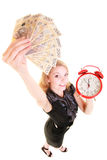 Woman holding polish money banknote and alarm clock. Stock Photography
