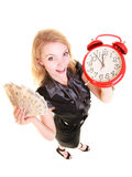 Woman holding polish money banknote and alarm clock. Royalty Free Stock Image