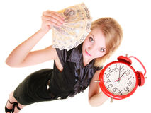 Woman holding polish money banknote and alarm clock. Stock Images