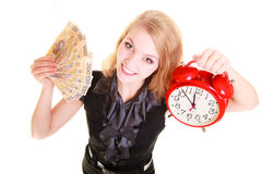 Woman holding polish money banknote and alarm clock. Royalty Free Stock Photos