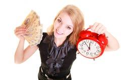 Woman holding polish money banknote and alarm clock. Royalty Free Stock Photos