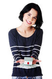 Woman holding polish zloty bills and house model Stock Image