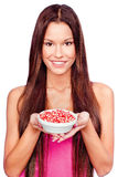 Woman holding pomegranate on plate. Young woman holding pomegranate on plate Royalty Free Stock Images