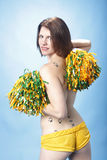 Woman holding pompoms Stock Photo