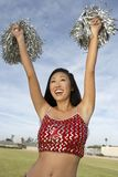 Woman Holding Pompoms Royalty Free Stock Image
