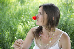 Woman holding a poppy Royalty Free Stock Photography