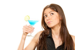Woman holding popular blue martini cocktail Royalty Free Stock Image