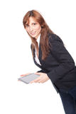 Woman holding a portable computer and smiling Royalty Free Stock Photography