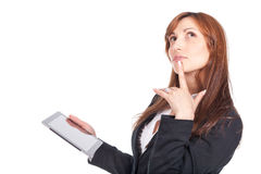 Woman holding a portable computer and thinking Royalty Free Stock Photo