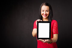 Woman holding portable device Stock Images